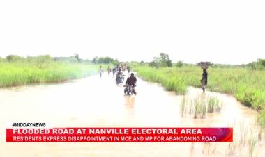 Residents left stranded after flooded road cut off community in Kujeri-Naville